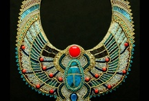 Scarabs / The Scarab (beetle)  is an ancient Egyptian amulet.  Some scarabs collected here are archaeological artifacts.  Others are modern representations of the scarab design.