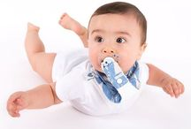 Bandummy Bib / The Bandummy bib is an imaginative design of a bandana bib combined with an extra part of fabric to attach your pacifier