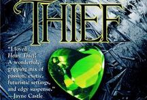 Heart Thief / #2 in the Heart Series, Ruis Elder, Null, thief, outcast, and Ailim D'SilverFir, Judge meet and love and struggle.  Sexier than all my other books, and a fan favorite.