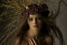 Headdress: FLOWER / The Headdress primarily adorned with flowers.