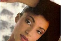 """Sade / Helen Folasade Adu, OBE, (born 16 January 1959), better known as Sade, is a Nigerian-born British singer-songwriter, composer, and record producer. She first achieved success in the 1980s as the frontwoman and lead vocalist of the Brit and Grammy Award-winning English group Sade. In 2002, she received an OBE from Prince Charles at Buckingham Palace for services to music, and she dedicated her award to """"all black women in England""""."""