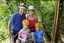 Family at Ka'ana / From horseback riding around Mayan ruins and ziplining through the treetops to feeding a rescued jaguar and learning how to make chocolate like the Maya - there's endless adventure for families to discover in Belize!