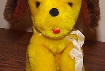 Dinky, my lost stuffed yellow dog / I'm looking for a replacement for my lost doggie toy I had when I was little. It was given to me as a gift when I was two or so, in the mid-late 70s. These are pins of similar looking stuffed puppies.  / by Lala K