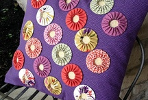 Yo Yo Cutie Pins / Seeing a second fabric is a modern yo-yo twist on an old favorite. Add a pin back or ribbon loop to decorate your life with little bundles of beautiful fabric. Add buttons, beads and more to dress up these Yo Yo Cutie Pins. / by Joan Hawley