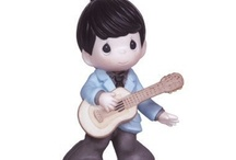 Precious Moments Elvis Presley / Precious Moments Elvis Presley Figurines at CollectibleShopping.com. The King of Rock and Roll is back in these Elvis Inspired Figurines. #Elvis #PreciousMoments #Elvis Presley