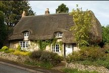 English  country cottages (and Gt. Britain) / No matter what village one visits in England, there will undoubtedly be a lovely cottage with a profusion of cascading roses, thatch and a gated flower garden!   / by Margo Carroll
