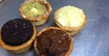 Pork Pies made by The York Pie Company / We provide a wide range of Pork Pies, including traditional. topped with various toppings and flavours, including but not limited to onion, stilton cheese, cranberry and stuffing, chillies, and thai flavours.
