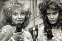 Night of the Comet (1984) -OlderGeeks.com /  A comet wipes out most of life on Earth, leaving two Valley Girls to fight the evil types who survive.  Director: Thom E. Eberhardt Writer: Thom E. Eberhardt Stars: Catherine Mary Stewart, Kelli Maroney, Robert Beltran