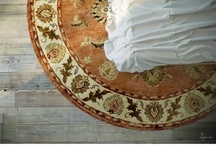 Area rug at the foot of the Bed