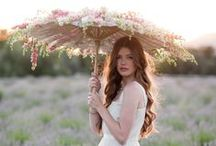 Umbrellas / Umbrellas & parasols are the perfect accessory for any outdoor wedding! It's a classy cover up for rainy-day romance or an elegant way to keep guests cool in summer.  Parasols can be a unique alternative to the usual flower bouquet!