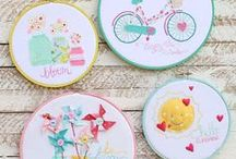 hoops / embroidery hoops altered with paper, ribbon, button(s), and more.