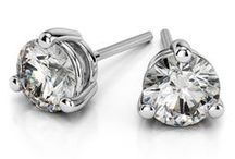 Diamond Earrings / Diamond Earrings showcase the fire and beauty of the diamond, and can be worn with anything from jeans to a bridal gown. Select Round, Princess or Asscher cut diamonds in a choice of 14K or 18K gold or platinum settings. To achieve maximum sparkle and fire, every pair of diamond studs is at least F-H in color and VS-SI in clarity. For more information about a specific piece, contact us at 1-866-737-0754 or service@brilliance.com