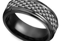 Carbon Fiber Men's Wedding Rings / Our Carbon Fiber Men's Wedding Rings are designed with the modern groom in mind! Need assistance or looking to get some advice before a purchase? For more information about a specific piece, contact us at 1-866-737-0754 or service@brilliance.com