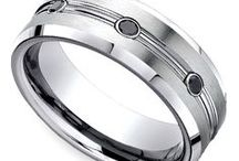 Black Gemstone Men's Wedding Rings / Our Black Gemstone Men's Wedding Rings are designed with the modern groom in mind! Need assistance or looking to get some advice before a purchase? For more information about a specific piece, contact us at 1-866-737-0754 or service@brilliance.com