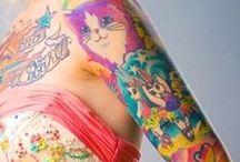 tattoos & piercings / by Lauren .