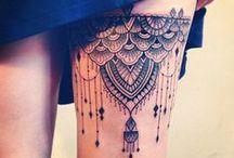 Tattoos / by Tabatha Shannon