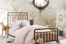 L's Room Ideas / A feminine room, something to grow with her.  Soft whites, aged wood, blush/pink, antique/aged brass, gold and silver, gray and a few aged spa blue/smokey aqua accents.  Antique brass bed with distressed panel above.  Frilly, soft bedding.  White or wood nightstand and a French desk/vanity.  Large mirror or a mirrored closet with a ballet barre and little dress up hooks.  A large, pretty brass and pearl flower for over her antique white and gray dresser. / by Cori Evers