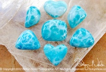 Larimar / Larimar is a rare form of pectolite, which was discovered in the 1974 and is only found in the Dominican Republic. It has an extraordinary blue appearance similar to the color of the ocean in tropical areas. It is also known as the Dolphin Stone. The name Larimar comes from a combination of Larissa and Mar and was given to the stone by a Dominican who named the stone after his daughter Larissa and Mar, the Spanish word for sea. It is my absolute favorite and I LOVE collecting it!