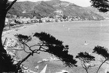 Frammenti di Liguria - Ligurian Landscapes / La bellezza della Liguria, aspra e scoscesa come le colline e gli strapiombi a picco sul mare, brillante come il bagliore del sole sulle onde, pacata e discreta come un anziano che si ripara dal caldo all'ombra di una palma e vivace come i bambini che giocano in spiaggia. Oggi come quasi un secolo fa, alcuni panorami sono immutati, mentre altri appaiono radicalmente diversi. Entrando nella bacheca potrete scoprire tutto questo!