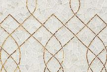 Aurora / New Ravenna is pleased to introduce the Aurora Collection designed by Sara Baldwin. The collection consists of 24 mosaic designs hand crafted in natural stone, 24k gold glass, jewel glass, and shell. Each mosaic consists of hundreds of small individual pieces that have been hand cut and assembled by artisans on the Eastern Shore of Virginia. Aurora was inspired by Sara Baldwin's travels to cities steeped in gilded history where architecture is punctuated by flashes of brilliant gold.  / by New Ravenna