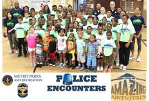 "LMPD & Metro Parks and Recreation hosted ""Police Encounters / Safety Workshop"" at Baxter Community Center Thursday, July 9, 2015. / Police Encounters and Safety Workshop held at Baxter Community Center Thursday, July 9, 2015."