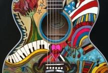 Guitars / by Emmy Meinschein