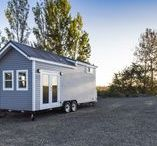26ft| Light Grey Tiny House / 26ft tiny home with split pitch roof and white/dark brown accents! This little gem has stolen our hearts! Complete with a cozy living space and functional kitchen, this home still lends plenty of room for a three piece bathroom and washer/dryer combo for laundry! Contact us today for information on pricing and customization options! *This exact home has been sold, however we build all our tiny homes custom, and we would love to build your tiny home for you!