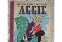 Aggie...  / Aggie Mack est à l'origine un comic strip créé par le dessinateur Hal Rasmusson en 1946 dans le Chicago Tribune. Cela raconte la vie d'une adolescente américaine, de sa famille et de ses amis.  Aggie, qui a perdu sa mère très jeune, vit avec son père le commandant Mack, sa belle-mère et sa demi-sœur Mona. Durant les longues absences de son père, Aggie devient le souffre-douleur de Mona et fait figure de Cendrillon moderne.