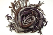 """Scarves / A scarf, also known as a muffler, warmstrangler or neck-wrap.Ancient Rome is one of the first origins of the scarf, where it was not used to keep warm, but to keep clean. It was called the sudarium, which translates from Latin to English as """"sweat cloth"""", and was used to wipe the sweat from the neck and face in hot weather.  Soon women started using the scarves, which were made of cloth and not made of wool, pashmina, or silk, and ever since the scarf has been fashionable among women."""