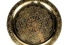 Entertaining: Brass Tea Trays / Moroccan Tea trays are round or oval and are made in silver or brass. They are hand-hammered with artistic intricate designs. We have a stunning selection of vintage and non-vintage trays.