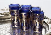 Entertaining: Tea Glasses / The use of Moroccan tea glasses has prolonged not only for drinking tea but for other purposes such as votive candle holders, decorative center pieces, party favors, and much more and they just make a great exciting gift. Style has been also stretched to water glasses, shot glasses, hand-blown lust colors with different designs from simple clear to more intricate and colorful, and are just beautiful to see.