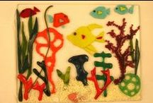 HANDCRAFTED BY JOAN / I am a fused glass & clay artist. I do many crafty things so if you are interested in making some things or buying let me know. At this moment fusing glass is my passion. I am also a stone carver so if you need something for your garden I may have it for you. / by Joan Pinkus