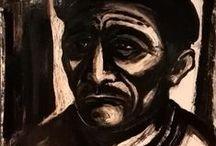 """""""I VOLTI DELLA MEMORIA"""" - Personale di Ielmo Cara / Ielmo Cara nasce nel 1934 a Gavorrano ma vive e lavora da sempre nel suo amato Sulcis. Le sue opere portano a tema i minatori e i paesaggi rurali della Sardegna, come documenti di luoghi di vita antica e di invito alla memoria di un tempo che appare remoto. Tecnicamente si distingue per l'uso sistematico del """"monotipo"""" che consiste nella stampa di un'unica copia di un disegno a chiaroscuro, eseguito su lastra metallica con inchiostro calcografico e trasportato su carta mediante pressione."""