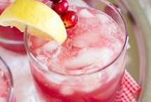 Jolly Christmas Mocktails for pregnant & breastfeeding mums / There's no need to feel left out of the festivities just because you're not drinking alcohol this Christmas. It's all in the presentation: red & white stripy paper straws, a festive napkin and a healthy dose of red berries thrown in the mix will soon make any drink more appealing Christmassy!  And we do love the frosty sugar rimmed glasses!