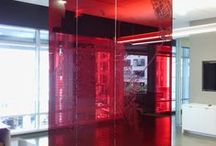 Translucent SF Map / 3M red translucent cut vinyl applied to red glass panels in downtown SF high-rise.