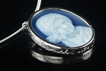 Cameos of Children / Portraits of children. Hand carved portraits in layered agate. Carved in a variety of styles white on blue, white on green, white on red and white on black layered agate. Cameo pendants,brooches and lockets.