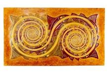 Modern designs / Decorative paintings made of wood covered with embossed leather.