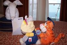 """Towel Animals / On Carnival and several other cruise lines, your cabin steward will bring your towels to """"life"""" in the shapes of animals.   We've had some very creative stewards over the years - they often make use of items in your cabin as well."""