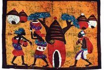 African Paintings / These Batik paintings are handmade in Gambia, Ivory Coast, Senegal and Kenya, They capture the beauty of an African princess, village workers, giraffe and elephant families, drum dancers and much more. Capture the beauty of the Maasai Warriors in the hand-crafted Maasai batik painting. These are all hand painted in bold vibrant colors.