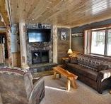 The Birch Suite / The adorable Birch Suite is a newly remodeled 1 bedroom, 2 bath cabin suite conveniently located next to our Main Lodge! The charming getaway has a large, tiered wooden deck with built-in benches and beautiful custom log and wrought iron posts and railings with covered entryway. The single level cabin features a beautiful Northwoods rustic décor, spacious bedroom suite, full gourmet kitchen, 2 full baths and a custom-built stone, wood burning fireplace.