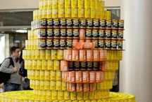 Cincinnati CANstruction 2014 / The 17th Annual Cincinnati Canstruction exhibit is now on display at various downtown locations. Last week, we got a little behind-the-scenes tour of the making of these amazing large-scale structures, which are made entirely out of canned goods. On Tuesday, March 11, teams of architects, engineers and construction firms had only five hours to put their skills and creativity to the test. In the short, but busy time they moved swiftly to turn stacks of canned goods into pieces of art.