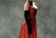 S-Bend, S-Curve, Edwardian Corsets / Corsets inspired by the S-bend from the Edwardian era, approximately the first decade of the 20th century. These are said to produce a very flat front, forward-tilted pelvis, and pronounced lumbar curve when worn.