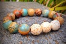 FeelingCharmed organic handmade bracelets / Bracelets made of organic and natural materials including recycled glass, seeds and wood. Available at FeelingCharmed  https://www.etsy.com/shop/FeelingCharmed?ref=search_shop_redirect