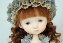 Muñecas y miniaturas