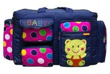 Travel Organizer Cotton Diaper Bags / Diaper Bags to stylishly contain every possible thing you might need for an outing with your baby. These Diaper Bags come with multiple smart pockets and comfortable straps so you can sling and go.
