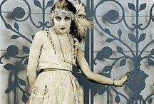 [1920s] ~ flapper style / │1920s flapper evening dresses │ loose shift dresses that allowed a lot of freedom for dancing │ drop-waist │often featured heavy beading and uneven hemline │ dancing dresses │20s vintage fashion │