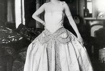 [1920s] ~ Robe de Style / │ Robe de Style was a popular alternative style of 1920s dress │ characterized by its full skirts (sometimes supported with petticoats, panniers, or hoops) │ the bodice could be fitted, or straight-cut with a dropped waist, but it was the full skirt that denoted the robe de style │ a signature design of couturier Jeanne Lanvin │ other couture houses with versions of the robe de style include Callot Soeurs, Lucile, Boué Soeurs │