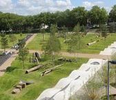 Drapers Field Recreation Ground - Playground Equipment / Drapers Field Recreation Ground, in Leyton, was redeveloped as part of the Olympic Legacy project. The design made use of topography and planting to create a rolling alpine landscape with large timber playground equipment dotted throughout.  The playground equipment consisted of cantilever swings, M frame swings, giant seesaws, slides, balance and stepping logs, climbing trees, climbing nets, trampolines and slides. It was all made out of large sections of oak and robinia.