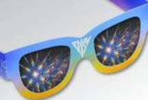 Fireworks & Rainbow Glasses / Fireworks Glasses® And Rainbow Glasses®, The Hottest Item Since The Sparkler....Specially Treated Holographic Lenses Break Light Into The Spectrum.