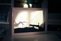 Shadow canvas / Shadows are casted from paper silhouettes on to the canvas from behind.
